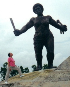 Faye visiting the Triumvirato Rebellion Monument in Matanzas Province, Cuba. She is admiring the image of Carlota, the rebel woman who was one of the leaders of a fierce slave revolt.  The leaders were publicly executed in the planter's desperate attempt to teach a lesson about costs of resisting the dehumanizing regime of enslavement.